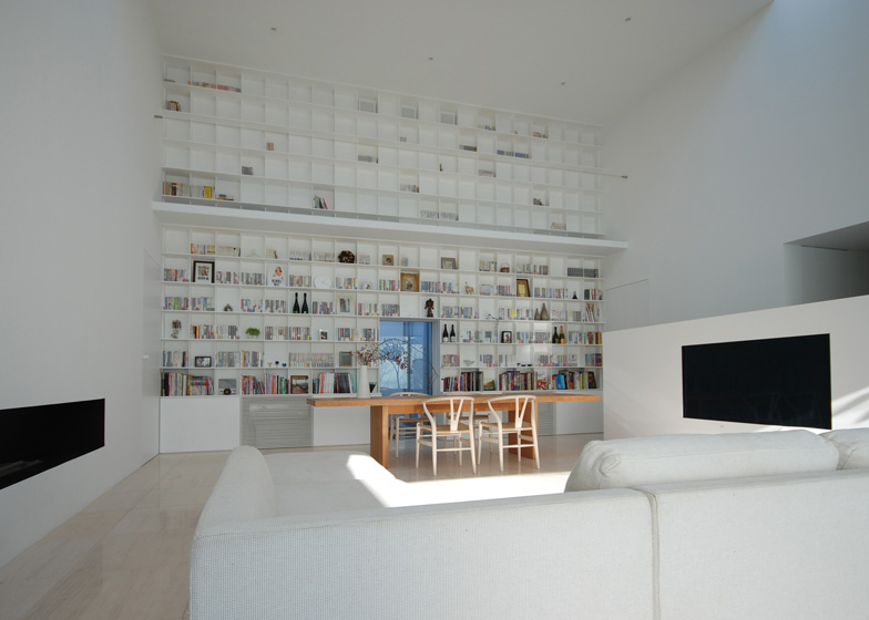 Ceiling Bookshelf library house | a 20-foot high floor-to-ceiling bookshelf | spoon