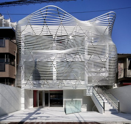 An Undulating Facade of Metallic Louvers Defines This Tokyo Residence and Store