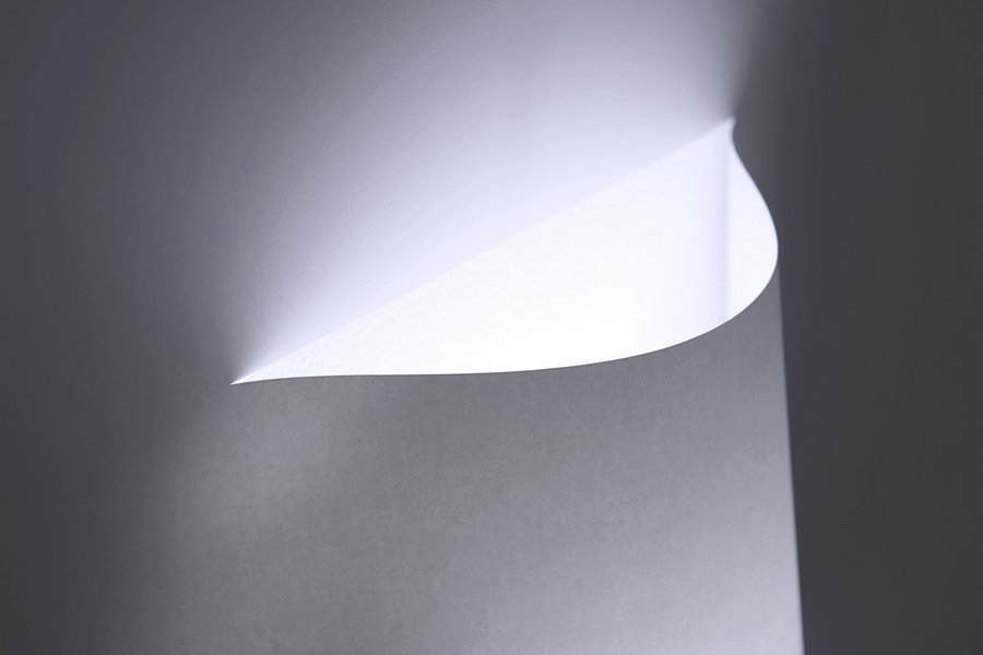 A minimal wall lamp made from a single sheet of paper spoon tamago yoy poster wall lamp aloadofball Images