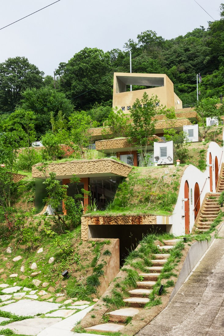 Greendo undulating geothermal homes built into the side House built into mountain