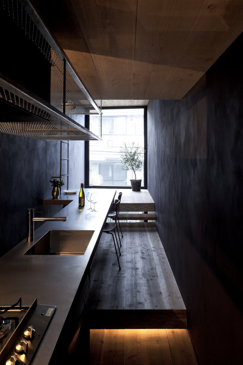 YUUA architects Madoka Aihara and Toshiyuki Yamazaki spearheaded this project, choosing an unconventionally dark palette to paint the walls to dramatize the light streaming in from the street.