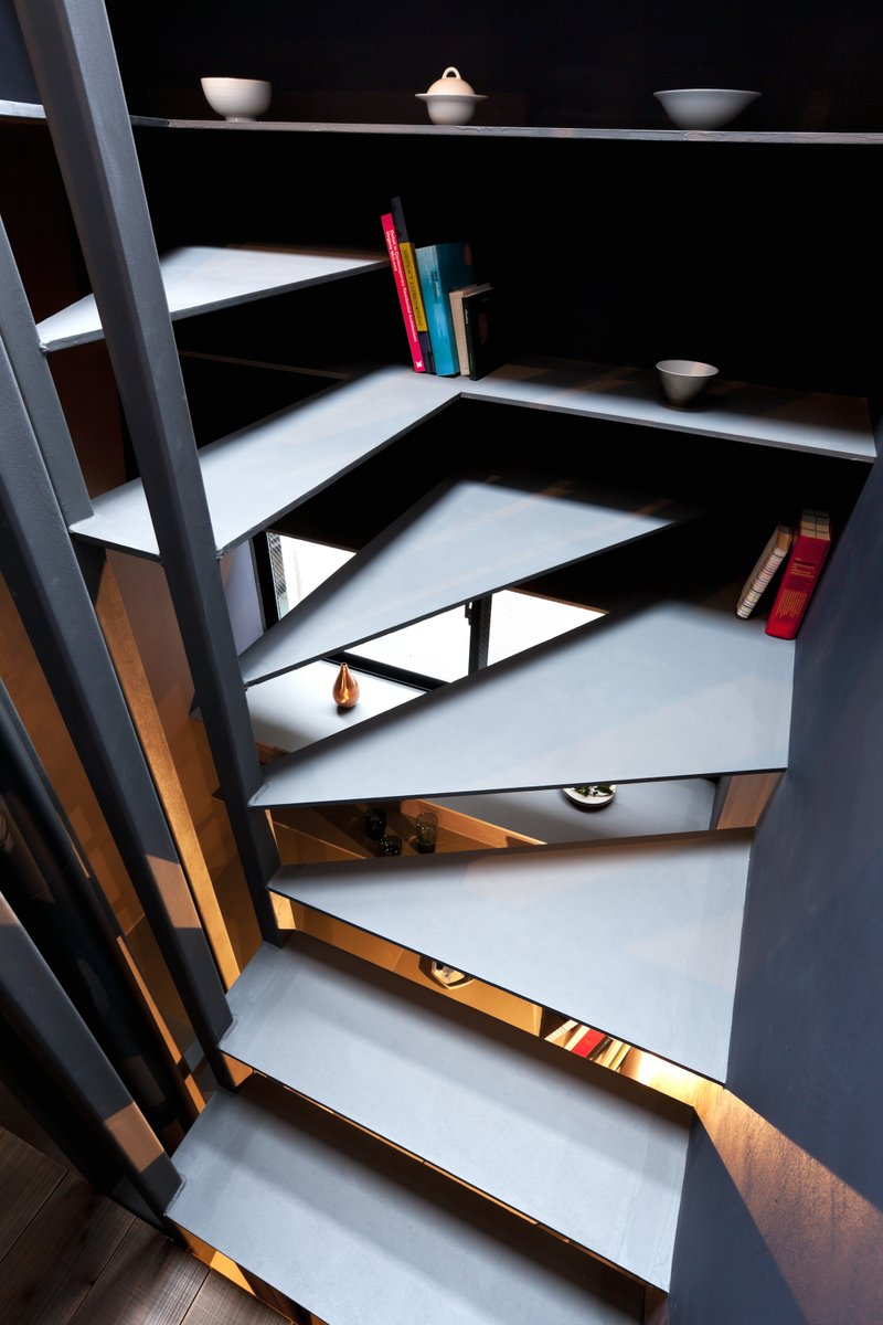 Minimalistic stairs slice their way through the space as you ascend to the next floor