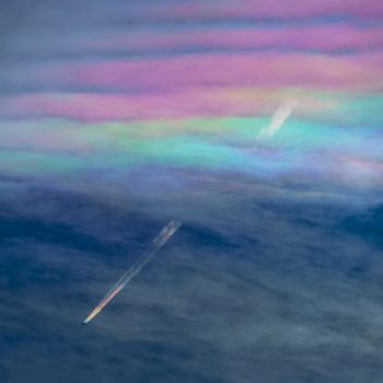Rare Photograph of Rainbow Contrails Created by Cloud Iridescence