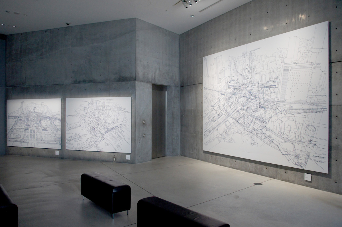 installation view of Tanaka's renderings at 21_21 Design Sight | image courtesy World Architetcs