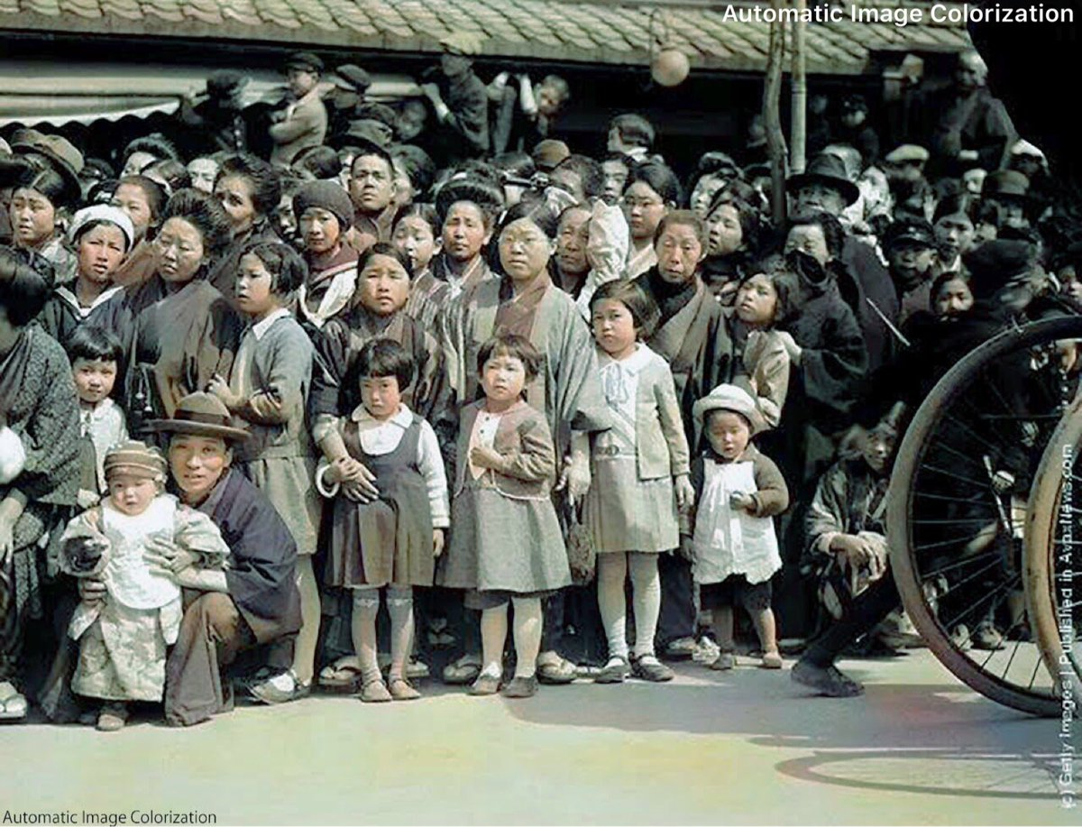 Woman and children wait for a parade on the streets of kobe 1930s photographer unknown