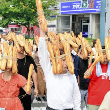Performance Artist Tatsumi Orimoto and His Facial Baguette Flash Mobs