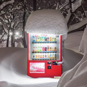 Japanese Vending Machines at Night Juxtaposed with a Wintry Hokkaido Landscape