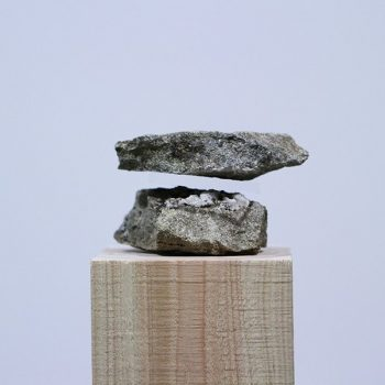 Photographs of Transparent Acrylic Perfectly Sandwiched Between Stacked Stones