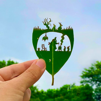 Kirie Artist Carves Playful Narratives Into Tree Leaves
