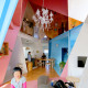 A Multifamily Apartment Turned Into a Multicolored Cross Section of Rooms